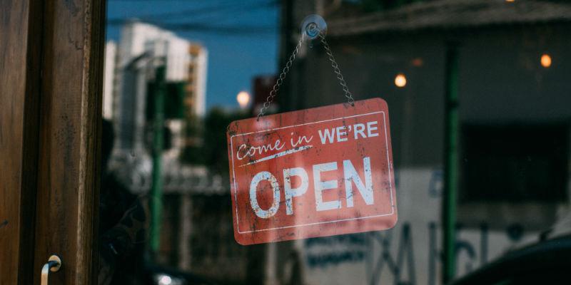 Open sign on a business door