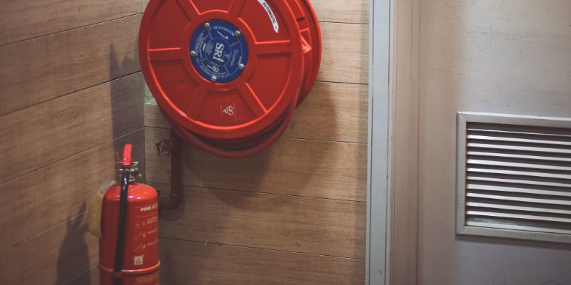 Fire extinguisher and hose in business building