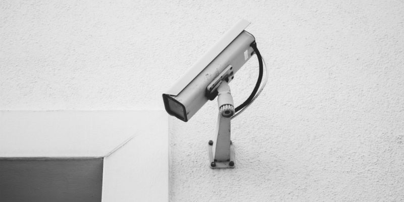 Old conventional CCTV camera on the wall of a business