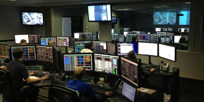 Team of experts remotely monitoring a security solution