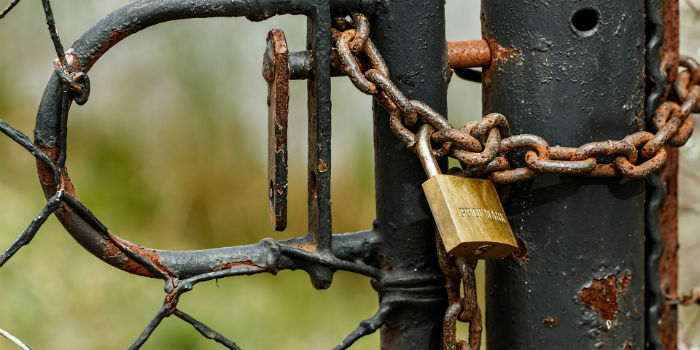 Rusty business gate padlocked together